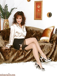 Cute slut MILF in stockings taking some hot posese