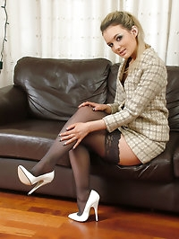 Cute babe Faye in silky smooth black nylons and pointy..