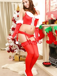 Cute redhead slips out of her Christmas outfit.
