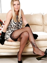 Newcomer Jenny on the sofa in black FFS nylons