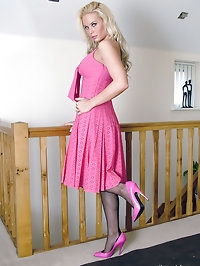 This honey looks stunning in a pink dress and high heels