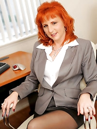Hot redheaded cougar satisfies herself with a dildo while..