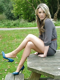 Gorgeous girl with dirty blonde hair and blue high heels..