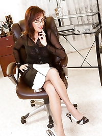 Splendid stockings on an office secretary MILF