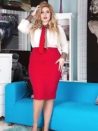 Curvy Ellie posing in her air hostess uniform with seamed..