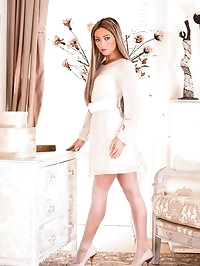 Looking almost virginal in simple short ivory shift..