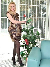 Blonde and beautiful, Affina Kisser is a Russian housewife..
