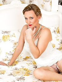 UK housewife Mrs. Huntington Smythe is lazing about in a..