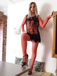 Decked out in an outfit made of sheer fishnets that open..
