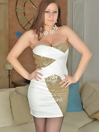A stunning dress clings to Lara Jade Deenes curvaceous..