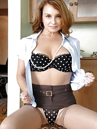Busty cougar Rebecca Bardoux makes her finger moist and..