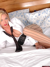 Sweetheart looks smart in tie and pantyhose