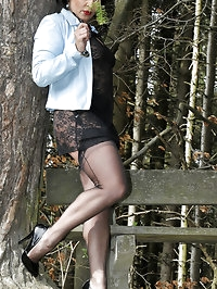 Girl in lacy dress poses outdoors