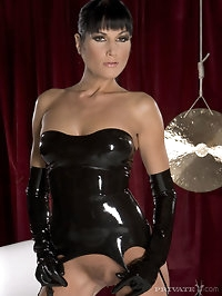 Wild babe in black latex has really long legs and nice ass
