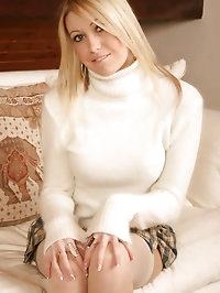 Poppy on sofa in white stockings