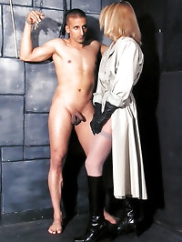 Sexy dominatrix in leather gloves ties up her submissive..