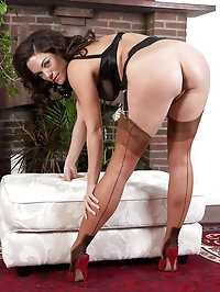 Rebekah Dee busty brunette black lingerie striptease