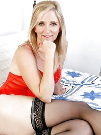55 year old Annabelle stabs at her mature pussy with a big..