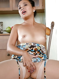 Classy Asian milf Lucky Starr fucks herself with a dildo..