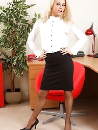 Michelle in the office with knee length skirt and grey..