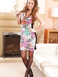 Cute Jess strips in the lounge in leggings and evening dress