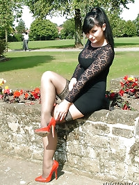 Sexy red heels make this curvy babe in black look fantastic