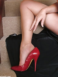 Hot leggy Milf Melinda flashes her shiny stockings and..