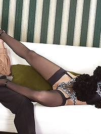 Hot babe does footjob in stockings