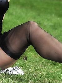 Amanda rolls around in the grass