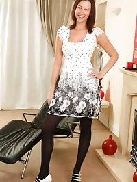 Carole wearing cute black and white dress.