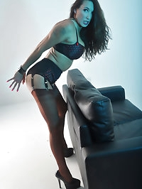 Nylon Jane has her hands bound and bends over a sofa