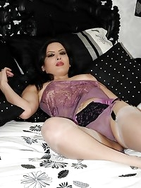 sexy brunette teases on bed