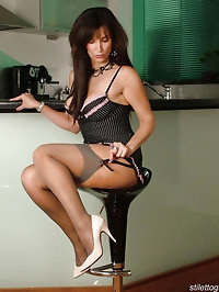 These creamy coloured high heels get this brunette nice..