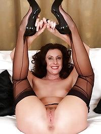 Long legged brunette MILF Lara Latex sporting hot black..