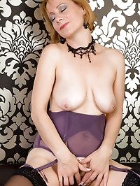 46 year old Tiffany T in purple lingerie spreading her..