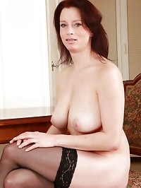 Busty and elegant redheaded MILF Carol swings her massive..