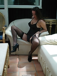 Lazing around at home in the sun in full nylon lingerie