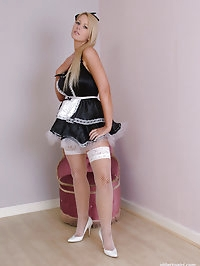 Sexy Maid Larissa in fishnet stockings and white stiletto..