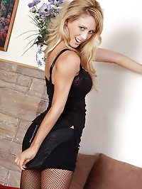 32 year old Cherie Deville in a elegant black dress strips..