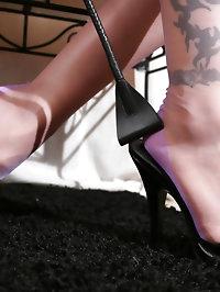 Nylon model Nadja undressing her pink nylons