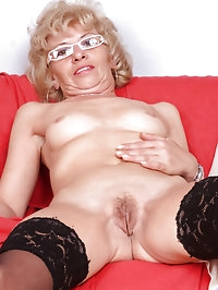 Lonely naked mature housewife Susan Lee comforts herself..