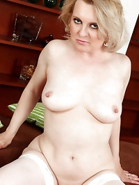 43 year old blonde Margeaux strips off her sexy white..