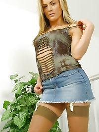 Sultry Lillia in denim mini and tan stockings