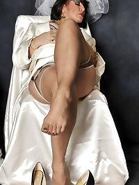 Elegant hottie is sexy in a beige dress
