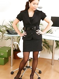 Stunner teases her way out of the sexy secretary outfit.