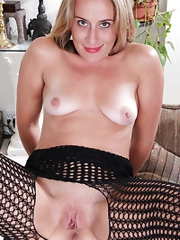 Horny and giggling blonde housewife spreading her long..